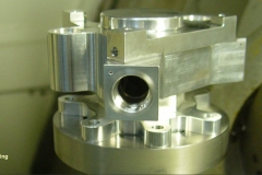 An aluminum housing being manufactured on a 5 axis machining center