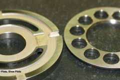 Wafer Plate and Shoe Nutating Plates used in bent axis pumps made from high speed steels with flatness requirements of .000035 and 4 Ra finishes